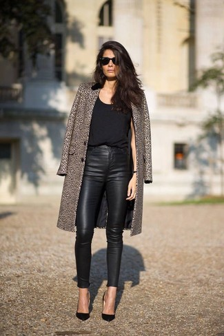 Consider teaming a black tank with black leather slim trousers to achieve a neat and proper look. A pair of black leather pumps will seamlessly integrate within a variety of outfits.