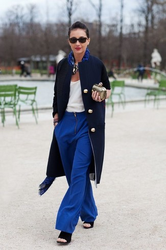If you like a more casual approach to dressing up, why not team a white tank with blue wide leg pants? Got bored with this ensemble? Enter black suede heeled sandals to shake things up. With spring in the air, it's time to make space for simple and beyond chic looks, just like this.