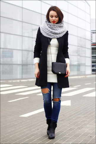 Step up your off-duty look in a black coat and blue destroyed slim jeans. This outfit is complemented perfectly with black leather ankle boots.