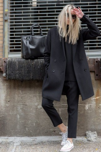 This combo of a black coat and black capri pants epitomizes comfort and style. Break up your ensemble with more casual shoes, such as this pair of white low top sneakers. This combo is super functional and will help you out in in-between weather.