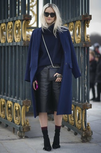 A navy coat and black culottes will showcase your sartorial self. Black suede pumps will add a touch of polish to an otherwise low-key look.
