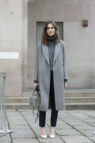 Team a grey coat with black vertical striped slacks for a sleek elegant look. White leather pumps are a nice choice to complete the look.