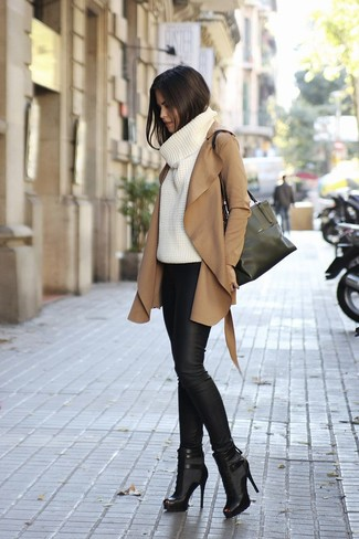 A camel coat and black leather leggings will showcase your sartorial self. Polish off the ensemble with black booties.