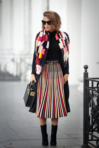 How to wear: black coat, black turtleneck, multi colored vertical striped midi skirt, black suede ankle boots