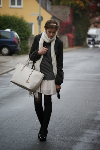 How to wear: charcoal coat, charcoal turtleneck, beige pleated silk mini skirt, grey leather tote bag