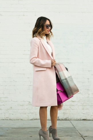 How to Wear Grey Suede Ankle Boots: This combo of a pink coat and a dark brown pencil skirt is ideal when you need to look nice but have no extra time. A pair of grey suede ankle boots serves as the glue that will bring your look together.