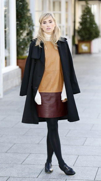 How to wear: black coat, white turtleneck, tan leather shift dress, black leather loafers