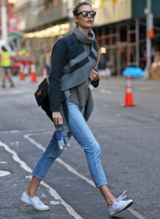 How to Wear White Canvas Low Top Sneakers For Women: This combination of a charcoal coat and light blue skinny jeans will be definitive proof of your styling prowess even on dress-down days. White canvas low top sneakers are a fail-safe way to bring a sense of stylish casualness to this outfit.