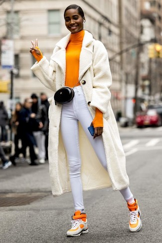 How to wear: white fleece coat, orange turtleneck, white skinny jeans, orange high top sneakers