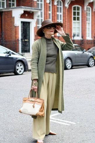 Wear an olive coat and yellow wide leg pants for a sleek elegant look. Throw in a pair of brown leather ballerina shoes to loosen things up. A look like this makes it easy to embrace unpredictable transeasonal weather.