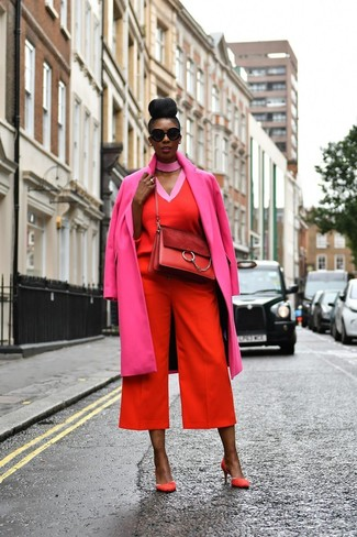How to wear: hot pink coat, red v-neck sweater, red culottes, red suede pumps