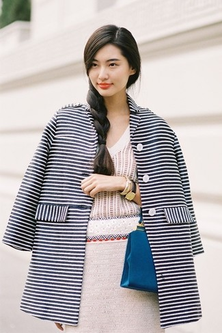 How to wear: navy and white horizontal striped coat, beige crochet v-neck sweater, beige crochet pencil skirt, blue leather clutch
