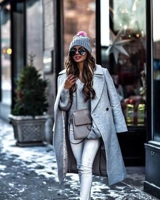 How to wear: grey coat, grey v-neck sweater, grey skinny jeans, grey leather satchel bag