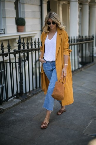 If you don't like getting too predictable with your combos, pair a mustard coat with blue denim culottes. Take your ensemble into a more casual direction with brown leather flat sandals. No doubt, it's easier to work through a super hot warm weather afternoon in a easy and breezy getup like this one.