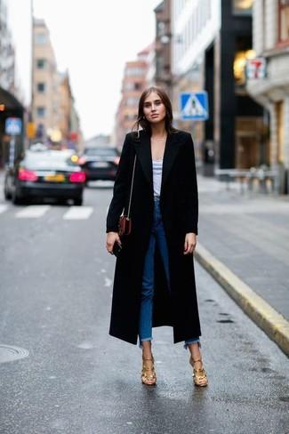 How to wear: black coat, grey v-neck t-shirt, blue fringe jeans, gold leather heeled sandals