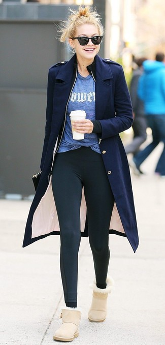How to wear: navy coat, black zip sweater, blue print crew-neck t-shirt, black leggings