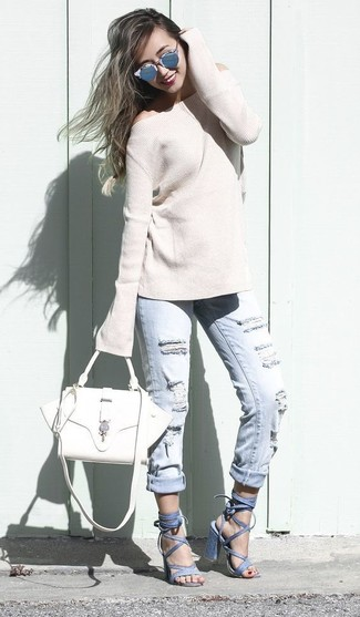 Reach for a beige crew-neck sweater and light blue ripped boyfriend jeans for a relaxed take on day-to-day wear. Dress up your getup with Giuseppe Zanotti Design Alien 115 Cage Sandals. An ensemble like this is ideal for unpredictable spring weather.