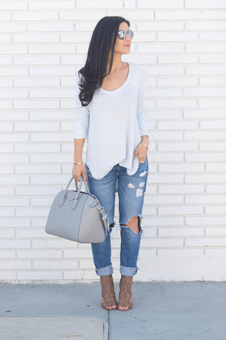 How to Wear Blue Ripped Boyfriend Jeans: This combination of a grey crew-neck sweater and blue ripped boyfriend jeans is a safe bet for an effortlessly cool look. Add a pair of brown leather heeled sandals to the equation to easily bump up the oomph factor of any look.