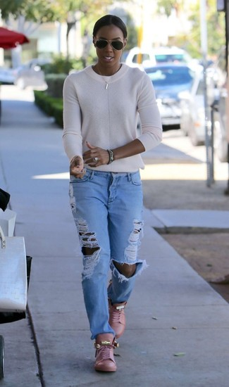 How to wear: white crew-neck sweater, light blue ripped boyfriend jeans, pink leather high top sneakers, black sunglasses