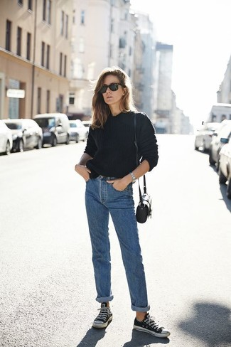 How to wear: black crew-neck sweater, blue boyfriend jeans, black and white canvas low top sneakers, black leather crossbody bag