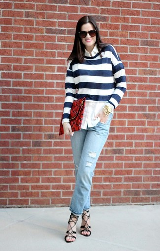 A white striped crew-neck pullover and baby blue jeans are perfect for both running errands and a night out. Opt for a pair of black heeled sandals to va-va-voom your outfit.