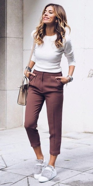 A nicely put together combination of a white crew-neck sweater and dark brown capri pants will set you apart effortlessly. To bring out the fun side of you, finish off your getup with white leather low top sneakers. As the weather starts to get warmer, it's time to get rid of those bulky winter gear and opt for something lighter, like this look here.