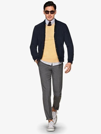 How to Wear Grey Canvas Low Top Sneakers For Men: This relaxed casual combination of a yellow crew-neck sweater and grey chinos is a never-failing option when you need to look cool but have no time. If you wish to easily tone down your ensemble with shoes, add grey canvas low top sneakers to the equation.