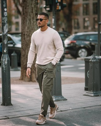 How to wear: white crew-neck sweater, dark green cargo pants, tan athletic shoes, black sunglasses