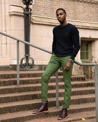 Green Pants Outfits For Men: Effortlessly blurring the line between cool and laid-back, this combo of a navy crew-neck sweater and green pants can easily become your favorite. To add elegance to your look, finish with burgundy leather casual boots.