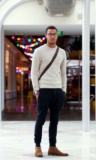 How to wear: grey crew-neck sweater, black chinos, brown suede desert boots, dark brown canvas messenger bag