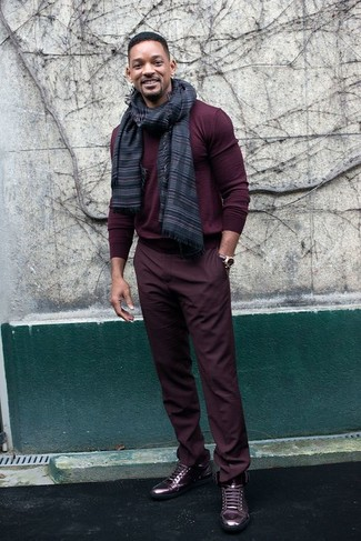 If you like a more relaxed approach to style, why not rock a burgundy crew-neck sweater with burgundy chinos? To bring out the fun side of you, complete your outfit with burgundy leather high top sneakers. This here is hard proof that one actually can survive the crazy heat, all while looking easy breezy.