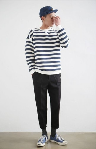 How to wear: white and navy horizontal striped crew-neck sweater, black chinos, blue canvas low top sneakers, navy baseball cap