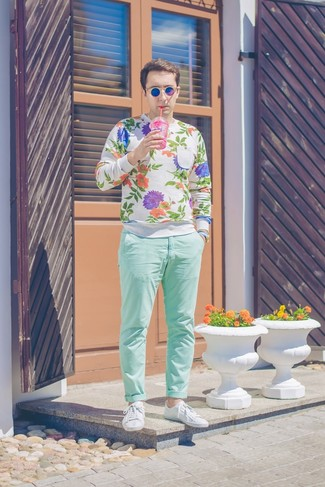 How to wear: white floral crew-neck sweater, mint chinos, white leather low top sneakers, blue sunglasses
