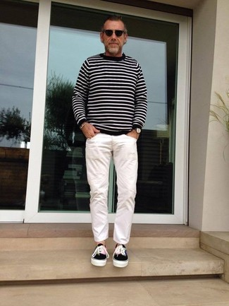 How to wear: black and white horizontal striped crew-neck sweater, white chinos, black canvas low top sneakers, black sunglasses