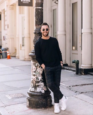 How to wear: black crew-neck sweater, navy plaid chinos, white leather low top sneakers, black sunglasses