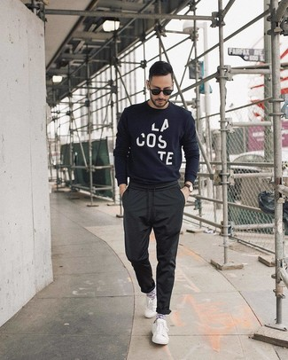 How to wear: navy and white print crew-neck sweater, black chinos, white low top sneakers, black sunglasses