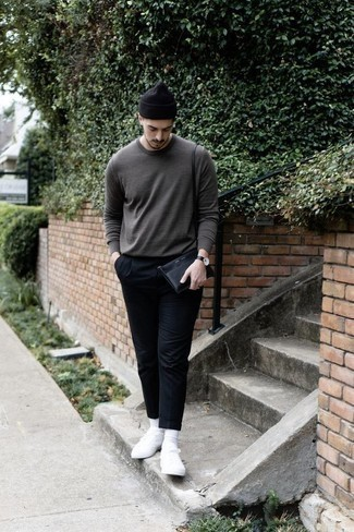 How to Wear a Grey Crew-neck Sweater For Men: If you're in search of a casual yet on-trend outfit, opt for a grey crew-neck sweater and navy chinos. For a more relaxed finish, why not complete your ensemble with white canvas low top sneakers?