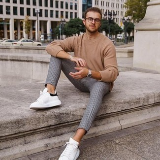Men's Outfits 2020: This combo of a tan crew-neck sweater and grey houndstooth chinos makes for the ultimate laid-back ensemble for any gent. White and black leather low top sneakers are a stylish complement to your look.