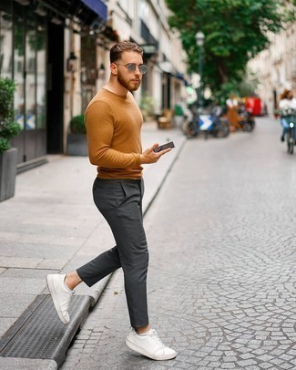 Tobacco Crew-neck Sweater Outfits For Men: Up your laid-back look by wearing a tobacco crew-neck sweater and charcoal chinos. Add a pair of white leather low top sneakers to this getup to instantly amp up the street cred of this look.