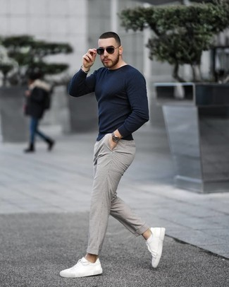Silver Beaded Bracelet Outfits For Men: This casual pairing of a navy crew-neck sweater and a silver beaded bracelet takes on different nuances according to how you style it. And if you wish to instantly kick up this look with footwear, why not complete your getup with white canvas low top sneakers?
