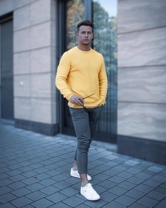 Charcoal Chinos Outfits: A mustard crew-neck sweater and charcoal chinos are a great outfit worth having in your day-to-day casual routine. If you wish to immediately dial down your getup with one item, introduce a pair of white canvas low top sneakers to the mix.