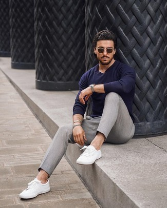 Navy Crew-neck Sweater Outfits For Men: Look amazing without really trying by wearing a navy crew-neck sweater and grey chinos. A pair of white leather low top sneakers instantly turns up the appeal of this look.