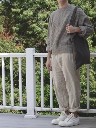Khaki Chinos Spring Outfits: Team a grey crew-neck sweater with khaki chinos for a casual kind of class. Go the extra mile and shake up your look by wearing a pair of white canvas low top sneakers. An amazing example of transitional fashion, this look is ideal come spring.