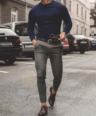 How to wear: navy crew-neck sweater, grey chinos, dark brown leather oxford shoes, dark brown leather belt