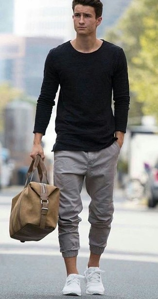 How to wear: black crew-neck sweater, black crew-neck t-shirt, grey chinos, white low top sneakers