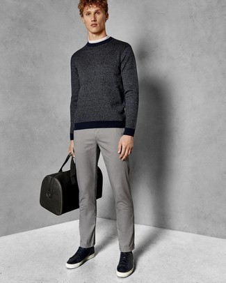 How to Wear a Leather Holdall For Men: To put together a relaxed casual ensemble with an urban take, opt for a navy vertical striped crew-neck sweater and a leather holdall. To give this ensemble a dressier touch, why not add a pair of black leather low top sneakers to the mix?