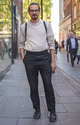 How to Wear a Beige Crew-neck Sweater For Men: You'll be surprised at how very easy it is for any gentleman to throw together this laid-back outfit. Just a beige crew-neck sweater and charcoal chinos. Take this outfit down a more elegant path by slipping into black leather derby shoes.