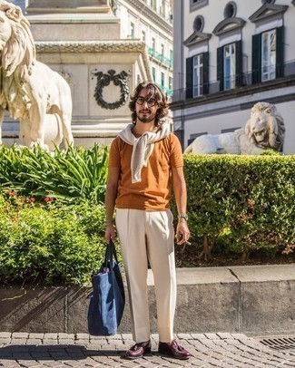 Burgundy Leather Tassel Loafers Outfits: Pairing a beige crew-neck sweater and beige dress pants is a surefire way to infuse polish into your closet. Burgundy leather tassel loafers are a savvy choice to round off your ensemble.