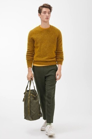 Crew-neck T-shirt Outfits For Men: A crew-neck t-shirt and dark green dress pants are the perfect base for an outfit. A pair of beige athletic shoes effortlessly boosts the street cred of this look.