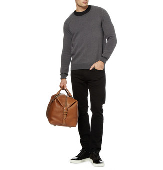 Brown Leather Holdall Casual Fall Outfits For Men: If it's ease and practicality that you appreciate in a look, try pairing a charcoal crew-neck sweater with a brown leather holdall. Balance out this ensemble with a more refined kind of shoes, such as this pair of black suede low top sneakers. It's is an appealing idea when it comes to a cool outfit that will take you from summer to fall.